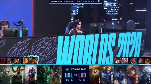 A UOL member preparing for a game on stage with the UOL and LGD drafts below