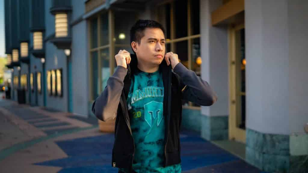 LCS player Xmithie flipping up his hood with an Immortals jersey underneath his jacket