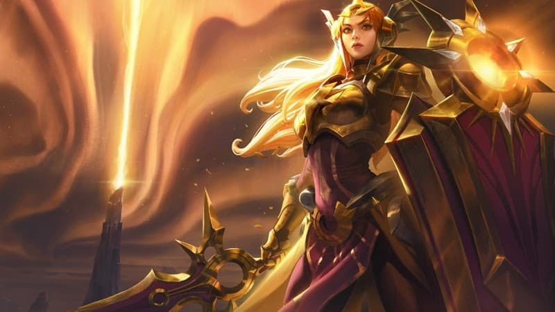 League of Legends Wild Rift champion Leona appears with her large shield and a bright gold aura in the sky with Mount Targon in the distance.
